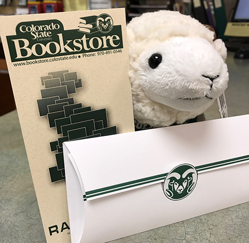 Image of a stuffed ram next to a CSU Bookstore Gift Certificate